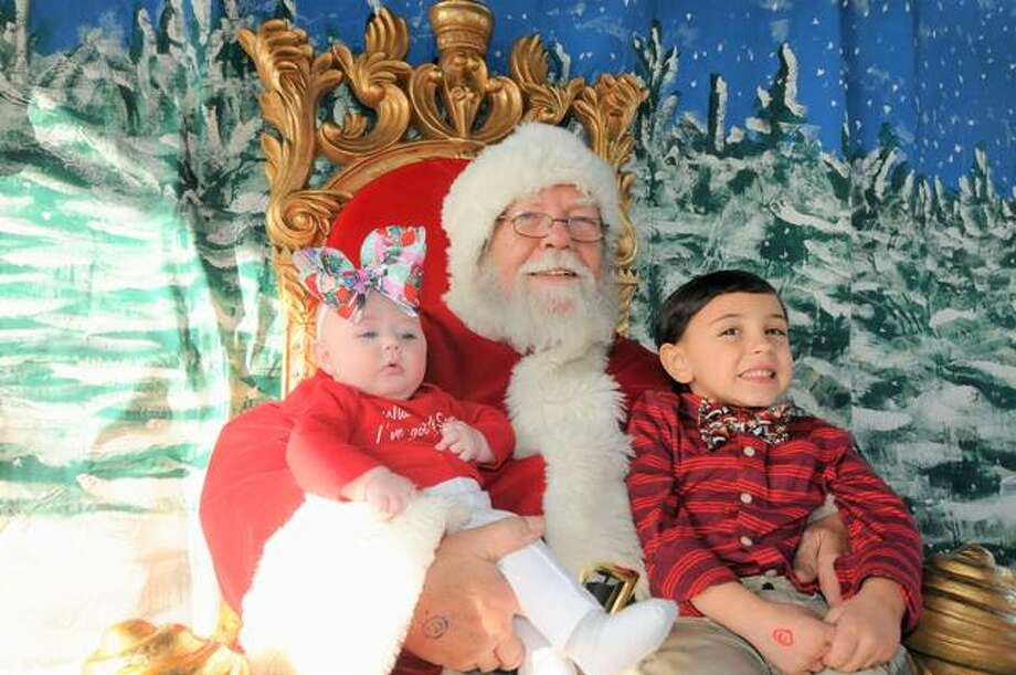 Four-month-old Sarina Barnes and her five-year-old brother Eli from Godfrey visit with Santa at Grafton's Grove Memorial Park. Photo: Photos By David Blanchette | For The Telegraph
