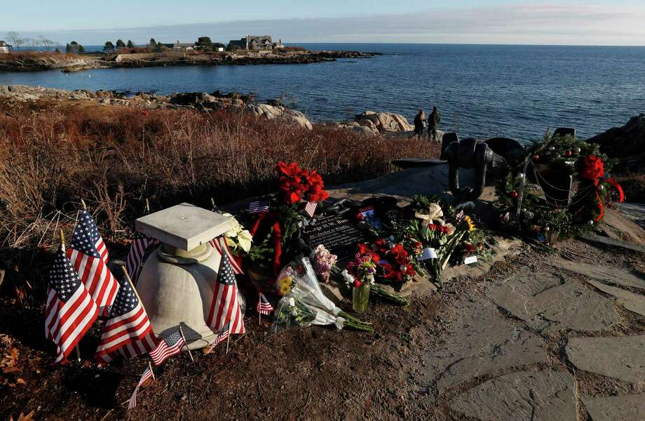 A makeshift memorial for President George H. W. Bush lay across from Walker's Point, the Bush's summer home, Saturday, Dec. 1, 2018, in Kennebunkport, Maine. Bush died at the age of 94 on Friday, about eight months after the death of his wife, Barbara Bush. (AP Photo/Robert F. Bukaty) Photo: Robert F. Bukaty / Copyright 2018 The Associated Press. All rights reserved.