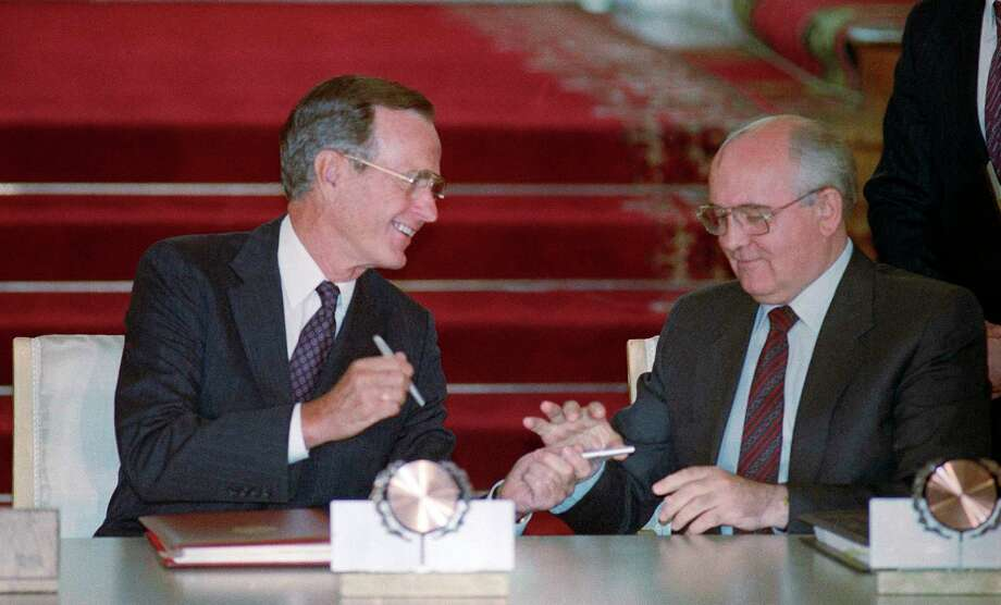 "FILE - In this file photo taken Wednesday, Aug. 1, 1991, U.S. President George H. Bush and Soviet President Mikhail Gorbachev exchange pens after signing the START arms reduction treaty in the Kremlin, Moscow. Former Soviet premier Mikhail Gorbachev expressed his ""deep condolences"" Saturday Dec. 1, 2018, to the family of former U.S President George Bush and all Americans following his death, aged 94. (AP Photo/Boris Yurchenko) Photo: Boris Yurchenko / Copyright 2018 The Associated Press. All rights reserved"