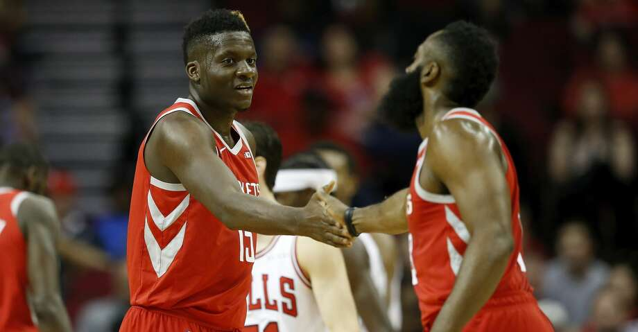 HOUSTON, TX - DECEMBER 01:  Clint Capela #15 of the Houston Rockets is congratulated by James Harden #13 in the first half against the Chicago Bulls at Toyota Center on December 1, 2018 in Houston, Texas.  NOTE TO USER: User expressly acknowledges and agrees that, by downloading and or using this photograph, User is consenting to the terms and conditions of the Getty Images License Agreement.  (Photo by Tim Warner/Getty Images) Photo: Tim Warner/Getty Images