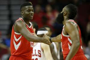 HOUSTON, TX - DECEMBER 01:  Clint Capela #15 of the Houston Rockets is congratulated by James Harden #13 in the first half against the Chicago Bulls at Toyota Center on December 1, 2018 in Houston, Texas.  NOTE TO USER: User expressly acknowledges and agrees that, by downloading and or using this photograph, User is consenting to the terms and conditions of the Getty Images License Agreement.  (Photo by Tim Warner/Getty Images)