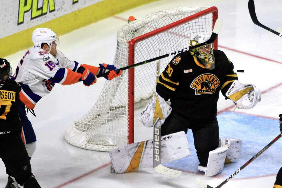 A shot attempt by Sound Tigers' Kieffer Bellows, left, is deflected by Providence goalie Dan Vladar during AHL hockey action at the Webster Bank Arena in Bridgeport, Conn. on Saturday Dec. 1, 2018. Photo: Christian Abraham / Hearst Connecticut Media / Connecticut Post