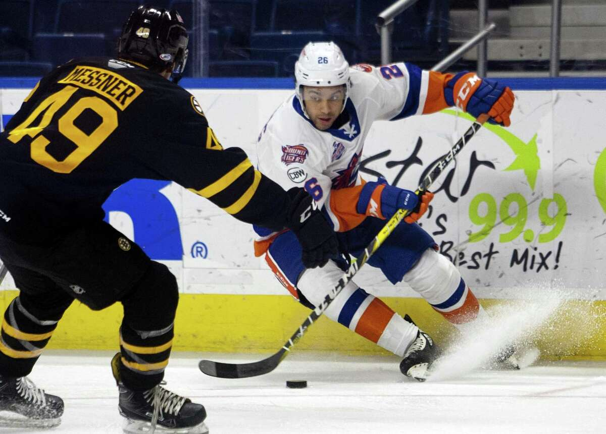 Sound Tigers' Josh Ho-Sang (26) brakes as Providence's Joel Messner (49) tracks during AHL hockey action at the Webster Bank Arena in Bridgeport, Conn. on Saturday Dec. 1, 2018.