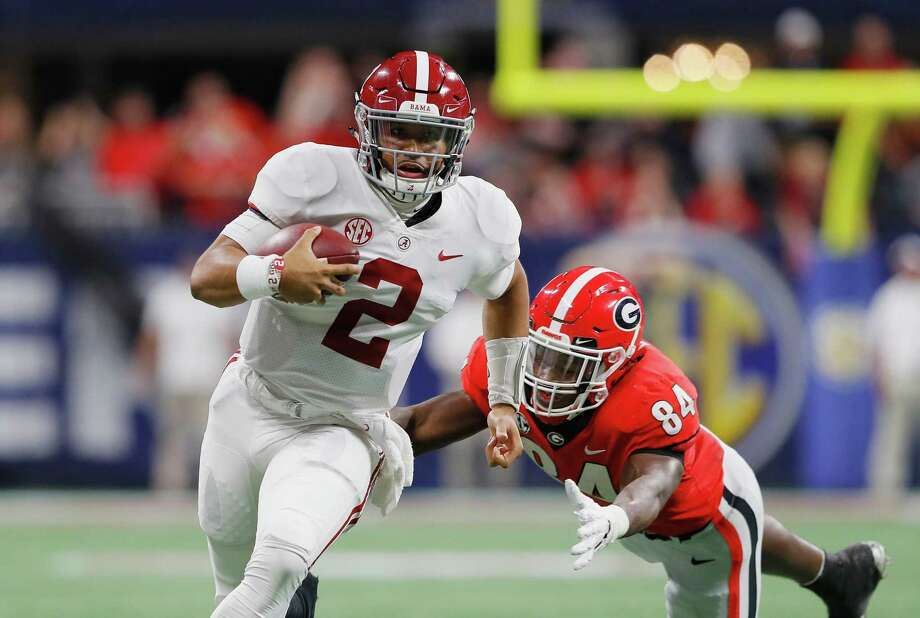 ATLANTA, GA - DECEMBER 01:  Jalen Hurts #2 of the Alabama Crimson Tide runs with the ball as Walter Grant #84 of the Georgia Bulldogs pursues him in the fourth quarter during the 2018 SEC Championship Game at Mercedes-Benz Stadium on December 1, 2018 in Atlanta, Georgia.  (Photo by Kevin C. Cox/Getty Images) Photo: Kevin C. Cox / 2018 Getty Images