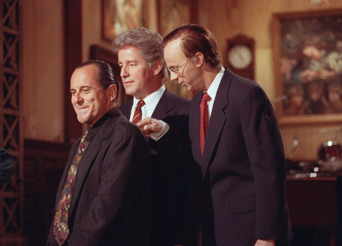 FILE--Actor Phil Hartman, center, in character as Gov. Bill Clinton, actor Joe Pesci, left, and Dana Carvey, right, as George Bush are shown in this Oct. 8,1992 file photo, as they tape a promotional spot for Saturday Night Live at NBC-TV studios in New York. Hartman was found shot to death in his home this morning, Thursday, May 28, 1998, and his wife fatally shot herself in an apparent murder-suicide as police were inside investigating. (AP Photo/Ron Frehm)