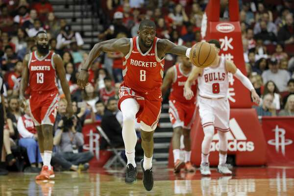 HOUSTON, TX - DECEMBER 01: James Ennis III #8 of the Houston Rockets dribbles on a fast break in the second half against the Chicago Bulls at Toyota Center on December 1, 2018 in Houston, Texas. NOTE TO USER: User expressly acknowledges and agrees that, by downloading and or using this photograph, User is consenting to the terms and conditions of the Getty Images License Agreement. (Photo by Tim Warner/Getty Images)
