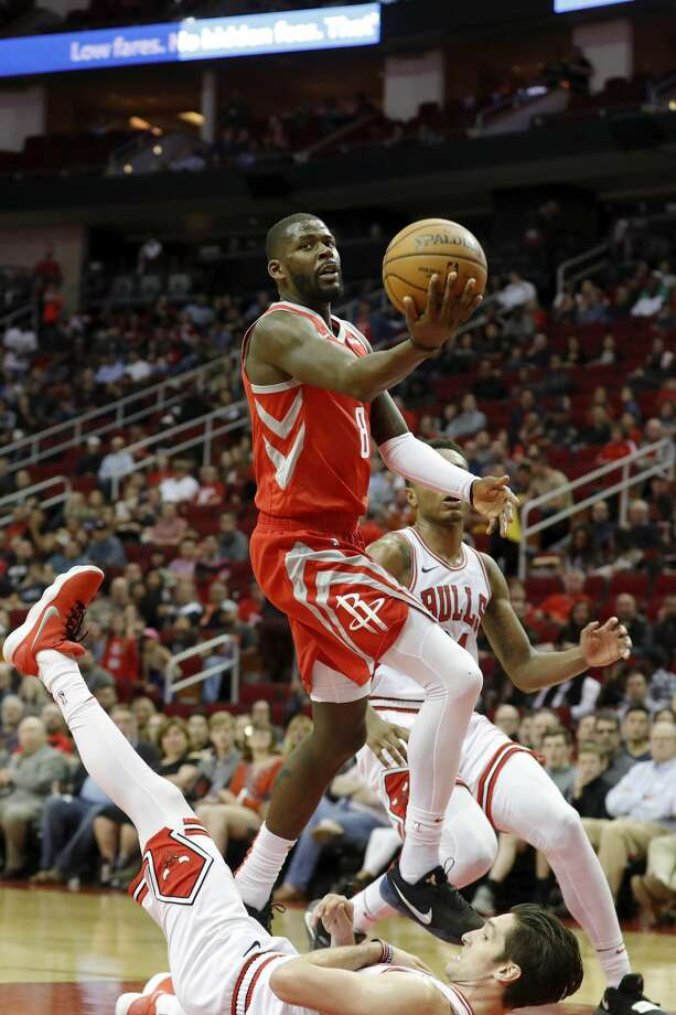 HOUSTON, TX - DECEMBER 01:  James Ennis III #8 of the Houston Rockets goes up for a shot defended by Ryan Arcidiacono #51 of the Chicago Bulls in the second half at Toyota Center on December 1, 2018 in Houston, Texas.  NOTE TO USER: User expressly acknowledges and agrees that, by downloading and or using this photograph, User is consenting to the terms and conditions of the Getty Images License Agreement.  (Photo by Tim Warner/Getty Images) Photo: Tim Warner/Getty Images