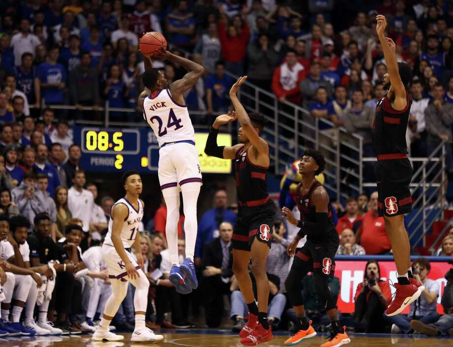 LAWRENCE, KANSAS - DECEMBER 01:  Lagerald Vick #24 of the Kansas Jayhawks makes a three-pointer in the final seconds of the  game against the Stanford Cardinal to send it into overtime at Allen Fieldhouse on December 01, 2018 in Lawrence, Kansas. (Photo by Jamie Squire/Getty Images) Photo: Jamie Squire / 2018 Getty Images