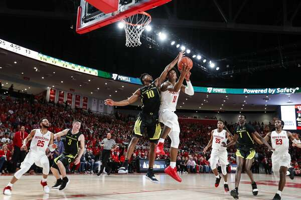 Houston guard Nate Hinton (11) takes the ball to the basket against Oregon guard Victor Bailey Jr. (10) during the first half on a NCAA basketball game at Fertitta Center on Saturday, Dec. 1, 2018, in Houston.