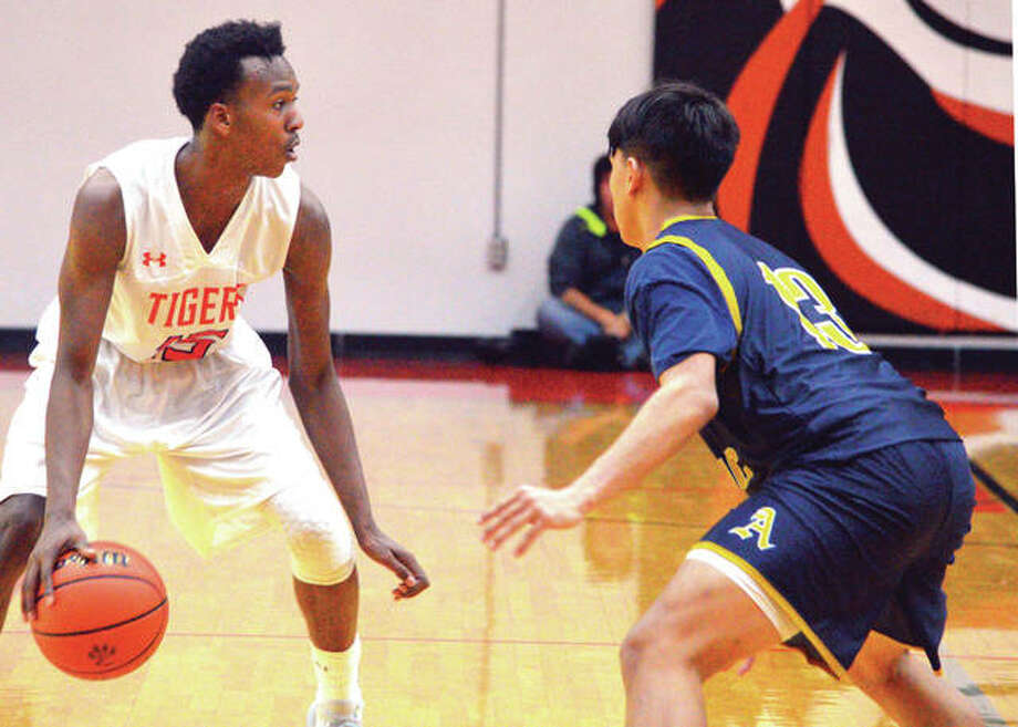 Edwardsville senior Jaylon Tuggle, left, tries to get past an Althoff defender during Saturday's game in the Scott Credit Union Shootout at Lucco-Jackson Gymnasium. Photo: Scott Marion/Intelligencer