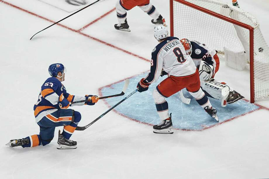 New York Islanders' Casey Cizikas, left, scores during the third period against Columbus Blue Jackets goalie Sergei Bobrovsky on Saturday, Dec. 1, 2018, in Uniondale, N.Y. (AP Photo/Andres Kudacki) Photo: Andres Kudacki / Copyright 2018 The Associated Press. All rights reserved.