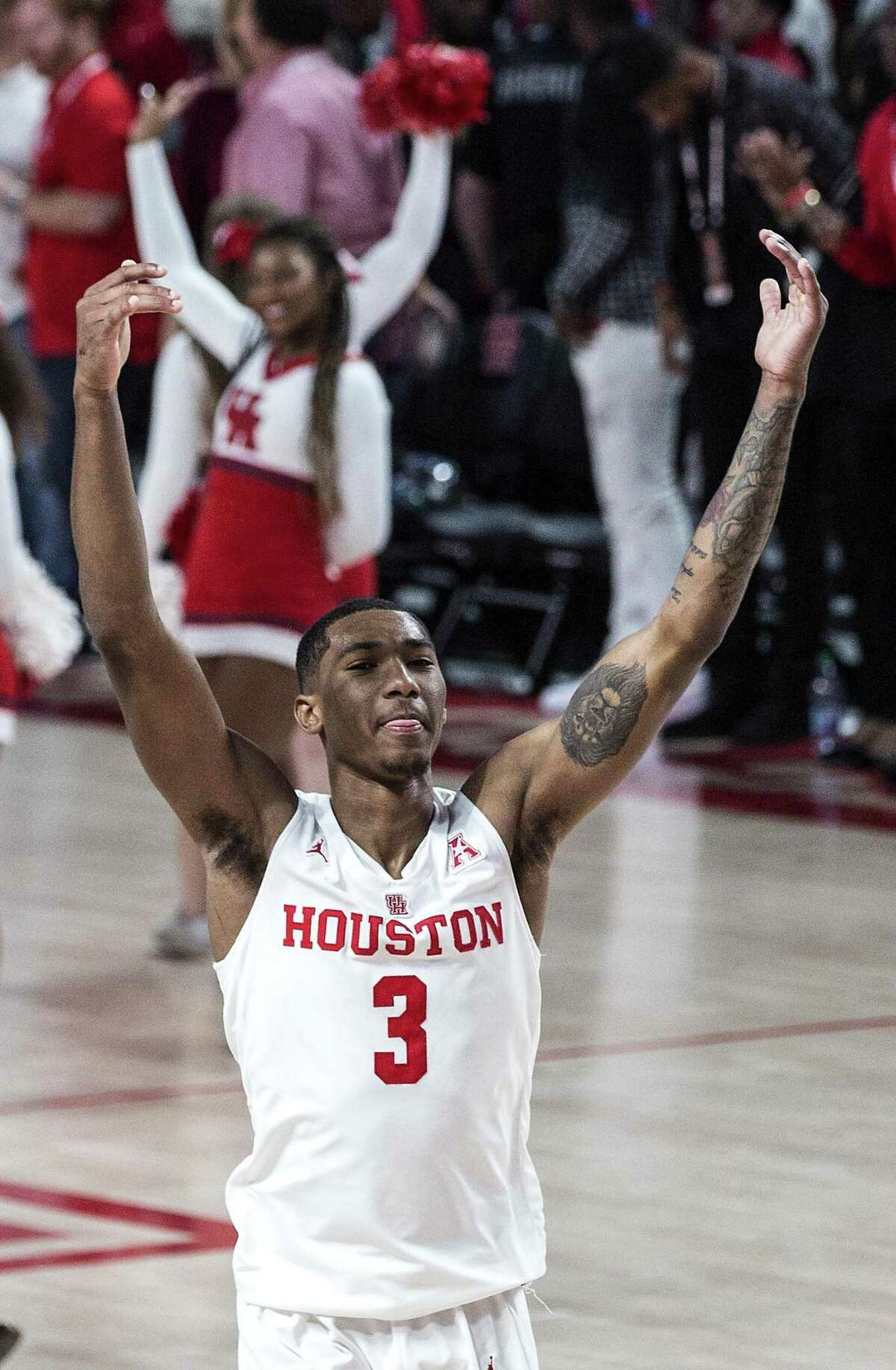 University of Houston guard Armoni Brooks celebrates as he runs off the floor after leading the Cougars with 22 points in a 65-61 win over No. 18 Oregon on Saturday night.