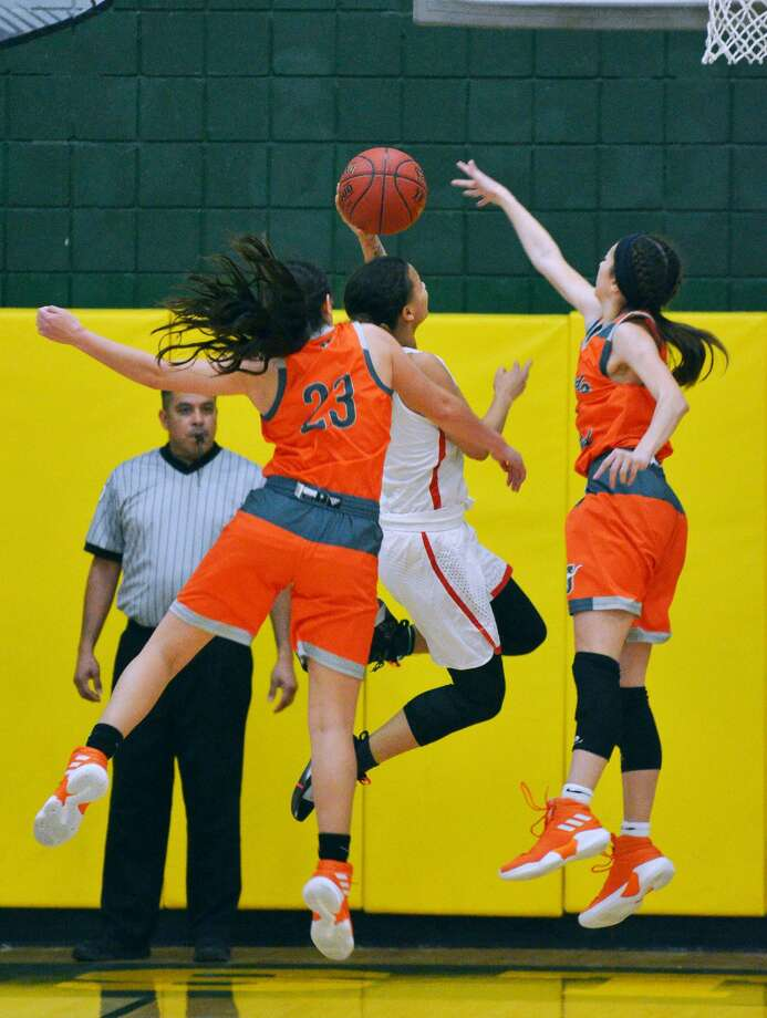 Natalia Trevino, Audrey Batey and United fell 66-57 against Judson on Saturday at Nixon in the UISD Hoopfest championship game. Trevino was named to the all-tournament team along with teammate Olivia Campero. Photo: Cuate Santos / Laredo Morning Times / Laredo Morning Times