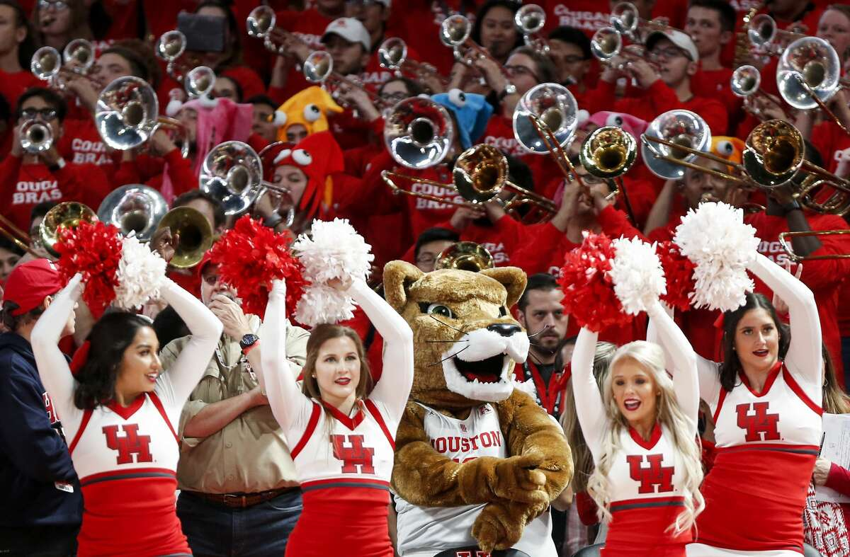 Houston cheerleaders, mascot and band perform during the second half on a NCAA basketball game against Oregon at Fertitta Center on Saturday, Dec. 1, 2018, in Houston.