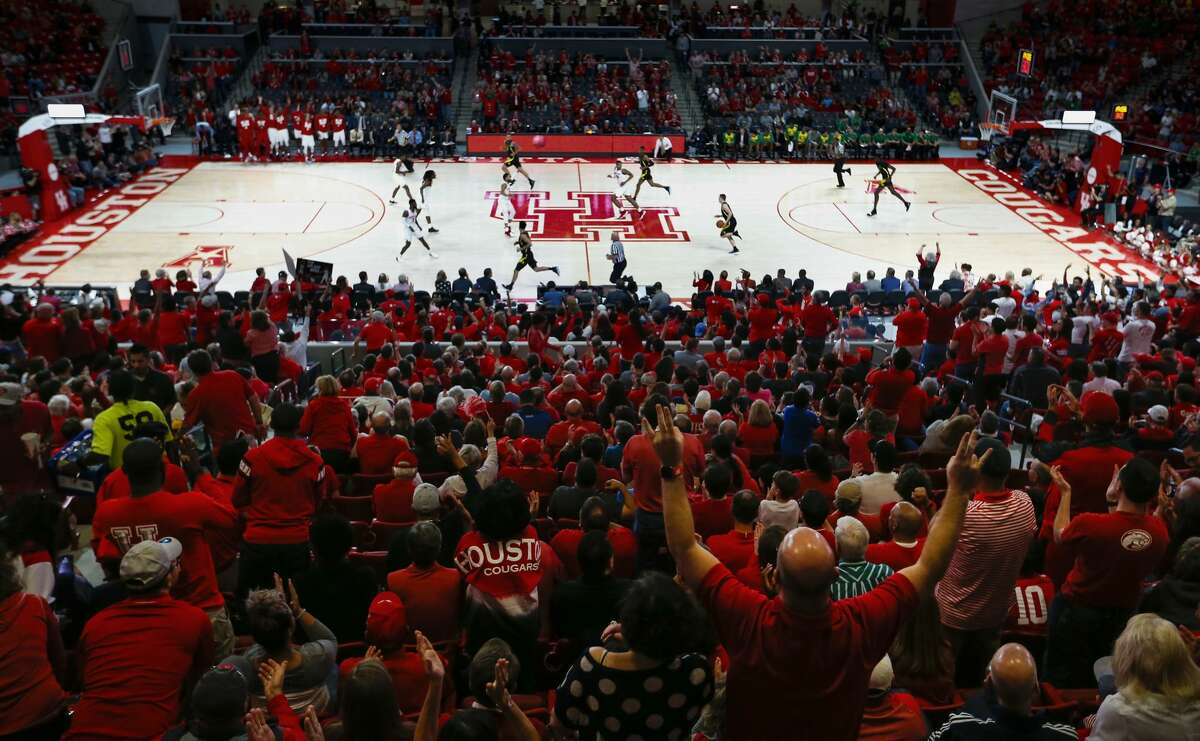 Houston fans cheer as the Cougars play in the inaugural NCAA basketball game at Fertitta Center against Oregon on Saturday, Dec. 1, 2018, in Houston.