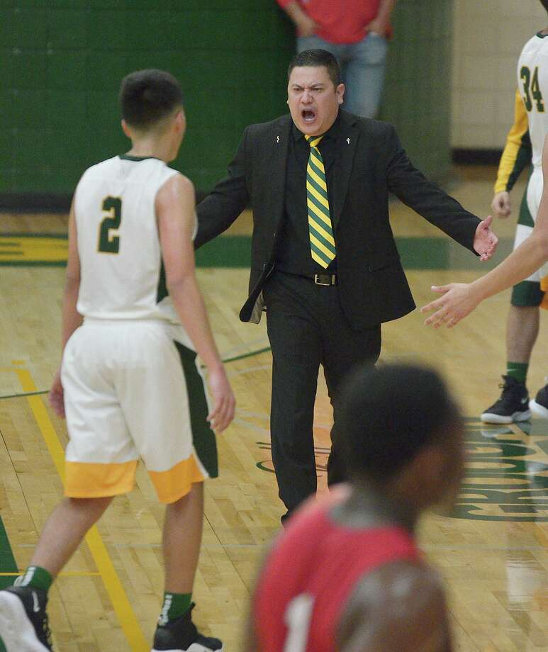 Pete Solis and Nixon finished 30-8 overall this season as they were narrowly eliminated with a 61-58 overtime loss in teh second round of the playoffs. Photo: Cuate Santos /Laredo Morning Times File / Laredo Morning Times