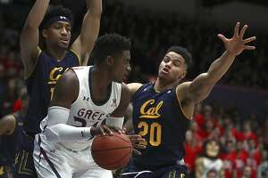 California's Matt Bradley, right, and Justice Sueing guard against St. Mary's Malik Fitts, center, in the first half of an NCAA college basketball game Saturday, Dec. 1, 2018, in Moraga, Calif. (AP Photo/Ben Margot)