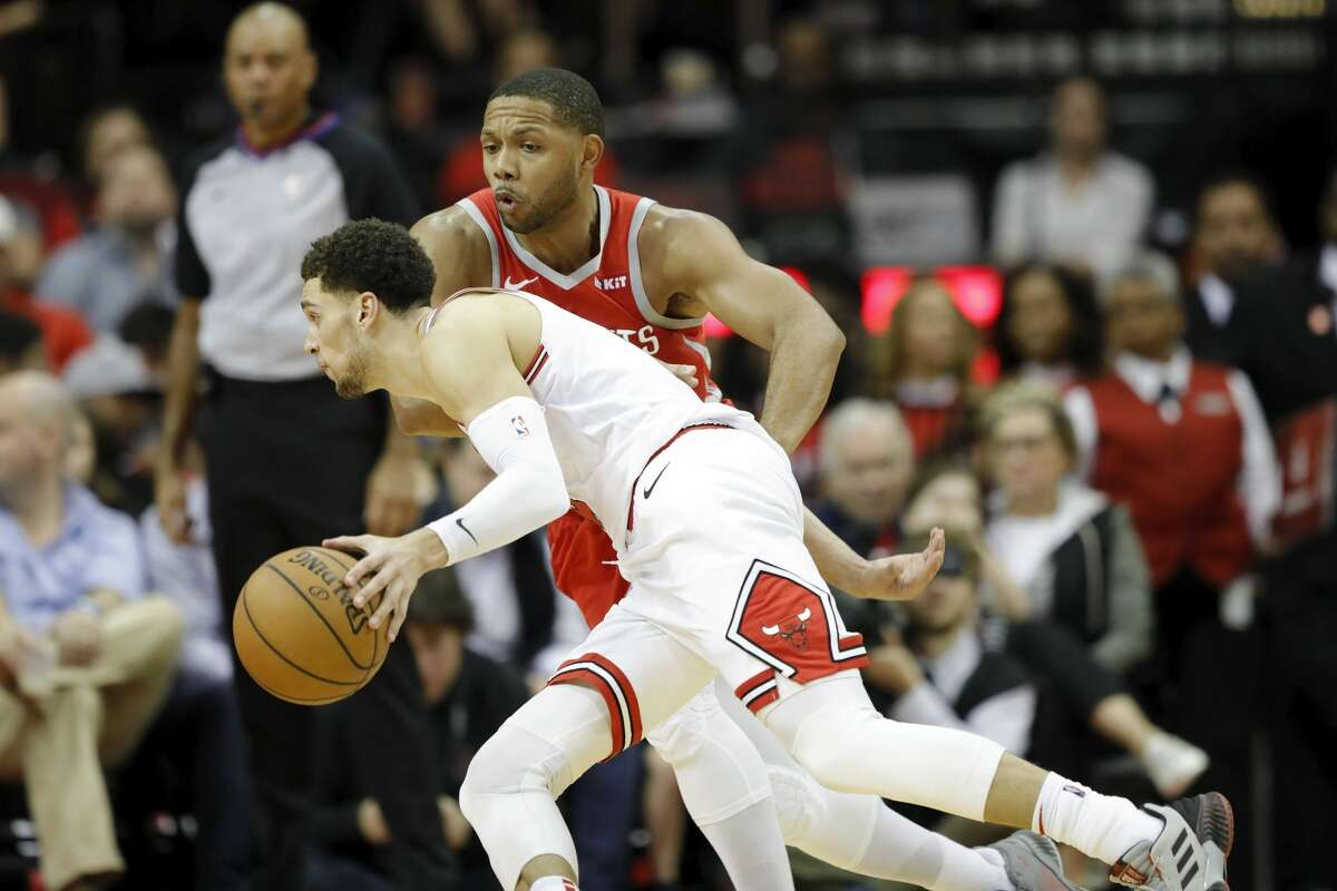 HOUSTON, TX - DECEMBER 01: Zach LaVine #8 of the Chicago Bulls drives to the basket defended by Eric Gordon #10 of the Houston Rockets in the second half at Toyota Center on December 1, 2018 in Houston, Texas. NOTE TO USER: User expressly acknowledges and agrees that, by downloading and or using this photograph, User is consenting to the terms and conditions of the Getty Images License Agreement. (Photo by Tim Warner/Getty Images)