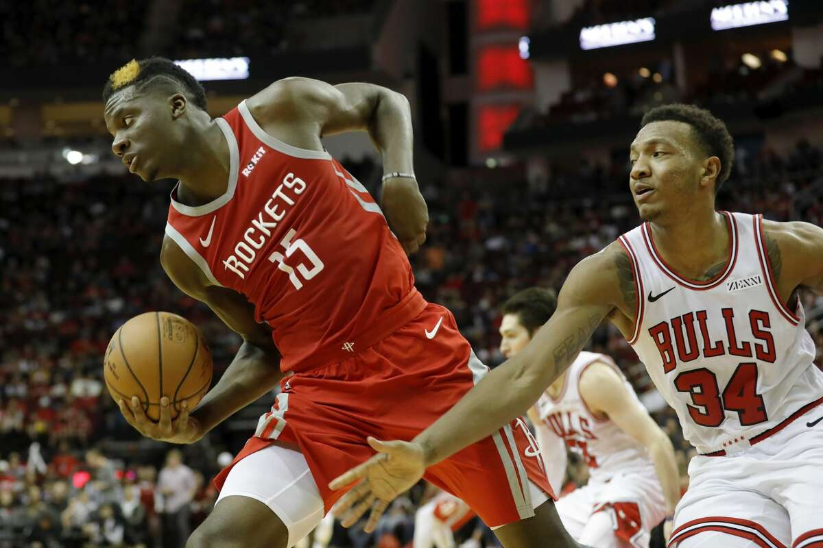 HOUSTON, TX - DECEMBER 01: Clint Capela #15 of the Houston Rockets and Wendell Carter Jr. #34 of the Chicago Bulls battle for a rebound in the second half at Toyota Center on December 1, 2018 in Houston, Texas. NOTE TO USER: User expressly acknowledges and agrees that, by downloading and or using this photograph, User is consenting to the terms and conditions of the Getty Images License Agreement. (Photo by Tim Warner/Getty Images)
