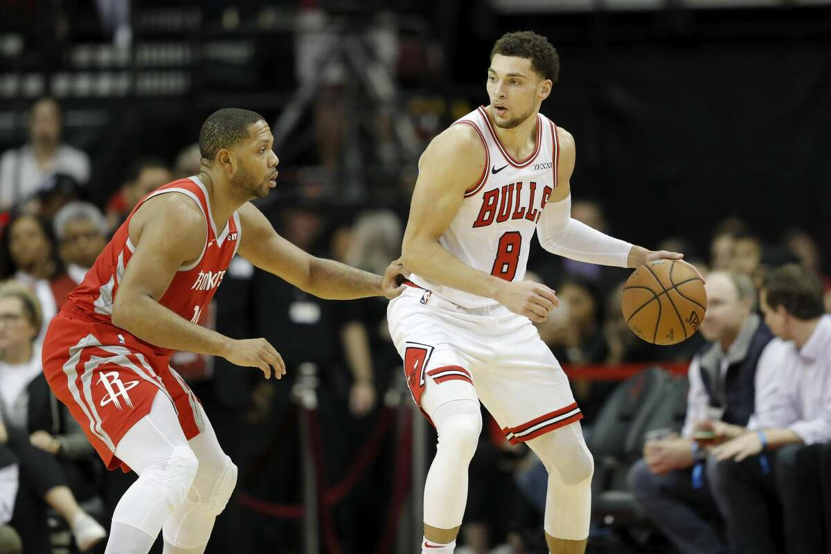 HOUSTON, TX - DECEMBER 01: Zach LaVine #8 of the Chicago Bulls controls the ball defended by Eric Gordon #10 of the Houston Rockets in the second half at Toyota Center on December 1, 2018 in Houston, Texas. NOTE TO USER: User expressly acknowledges and agrees that, by downloading and or using this photograph, User is consenting to the terms and conditions of the Getty Images License Agreement. (Photo by Tim Warner/Getty Images)