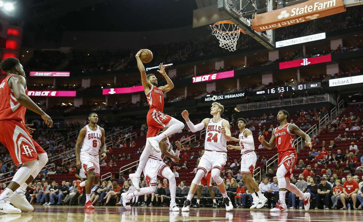 HOUSTON, TX - DECEMBER 01: Michael Carter-Williams #1 of the Houston Rockets goes up for a shot defended by Shaquille Harrison #3 of the Chicago Bulls and Lauri Markkanen #24 in the second half at Toyota Center on December 1, 2018 in Houston, Texas. NOTE TO USER: User expressly acknowledges and agrees that, by downloading and or using this photograph, User is consenting to the terms and conditions of the Getty Images License Agreement. (Photo by Tim Warner/Getty Images)