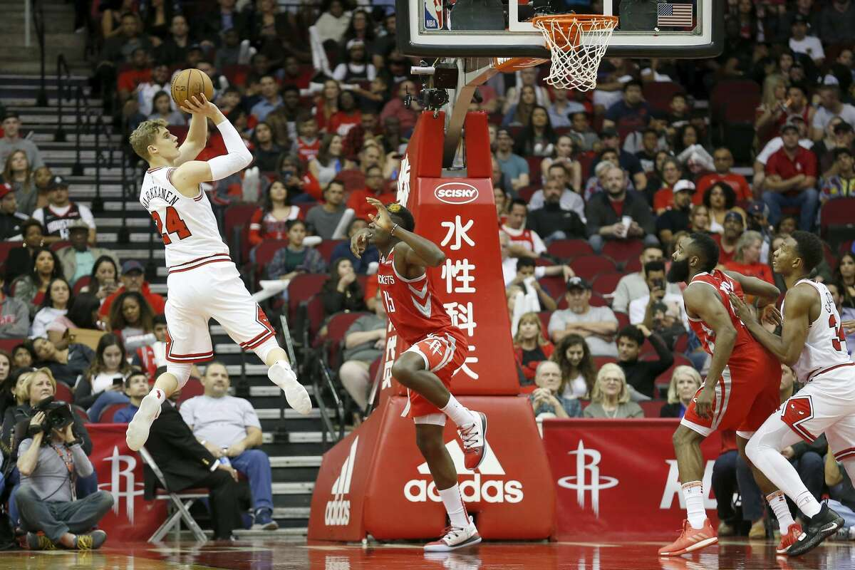 HOUSTON, TX - DECEMBER 01: Lauri Markkanen #24 of the Chicago Bulls takes a jump shot defended by Clint Capela #15 of the Houston Rockets in the second half at Toyota Center on December 1, 2018 in Houston, Texas. NOTE TO USER: User expressly acknowledges and agrees that, by downloading and or using this photograph, User is consenting to the terms and conditions of the Getty Images License Agreement. (Photo by Tim Warner/Getty Images)