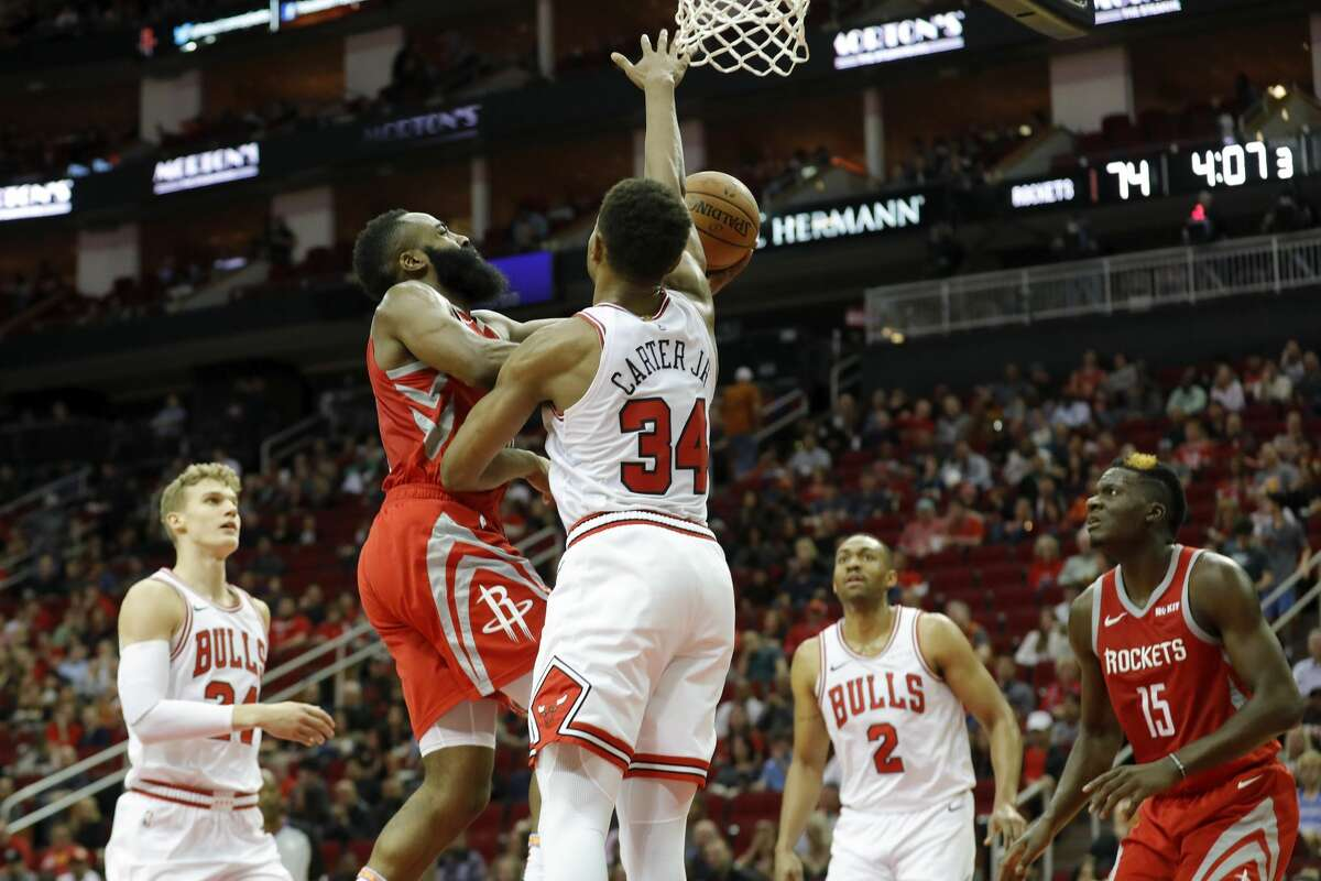 HOUSTON, TX - DECEMBER 01: James Harden #13 of the Houston Rockets goes up for a shot defended by Wendell Carter Jr. #34 of the Chicago Bulls in the second half at Toyota Center on December 1, 2018 in Houston, Texas. NOTE TO USER: User expressly acknowledges and agrees that, by downloading and or using this photograph, User is consenting to the terms and conditions of the Getty Images License Agreement. (Photo by Tim Warner/Getty Images)
