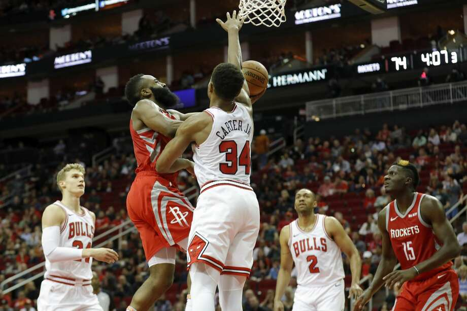 HOUSTON, TX - DECEMBER 01:  James Harden #13 of the Houston Rockets goes up for a shot defended by Wendell Carter Jr. #34 of the Chicago Bulls in the second half at Toyota Center on December 1, 2018 in Houston, Texas.  NOTE TO USER: User expressly acknowledges and agrees that, by downloading and or using this photograph, User is consenting to the terms and conditions of the Getty Images License Agreement.  (Photo by Tim Warner/Getty Images) Photo: Tim Warner/Getty Images