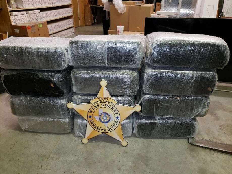 Shown are the loads of marijuana recently seized by Webb County Sheriff's Office. The two men in possession were arrested. Photo: Webb Co. Sheriff's Office/Courtesy