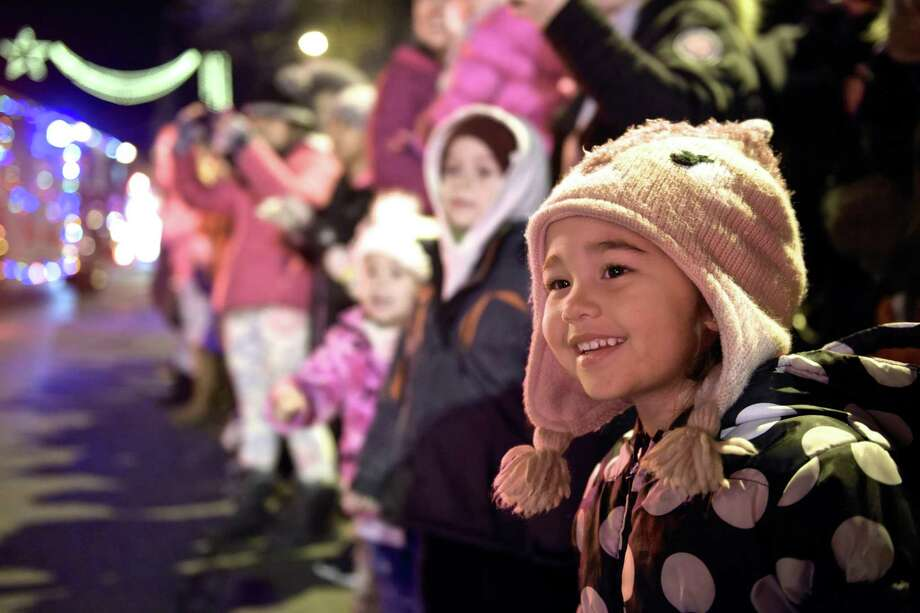 Anielly Wirag, 3, of Danbury, waits along Main Street for the firetruck parade and Santa during Light the Lights, Danbury's annual holiday festival presented by City Center Danbury. Saturday night, December 1, 2018, Danbury, Conn. Photo: H John Voorhees III / Hearst Connecticut Media / The News-Times