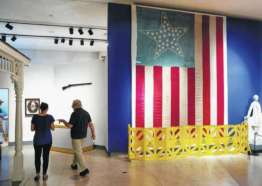 "A 14-foot high flag with 34 stars that flew in Schuyler County on the day of Abraham Lincoln's first inauguration in 1861 is one of the items featured in the Illinois State Museum's ""Bicentennial and Beyond: The Legacy Collection,"" an exhibit devoted to the state's 200th birthday at the Illinois State Museum in Springfield. The Land of Lincoln celebrates its 200th birthday on Monday with a bash in Chicago. Photo: Rich Saal 