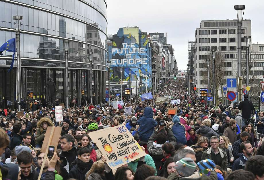 Demonstrators march on the European Union's headquarters in Brussels to show support for the bloc's proposed curbs on climate change. At least 65,000 people joined the march. Photo: Geert Vanden Wijngaert / Associated Press