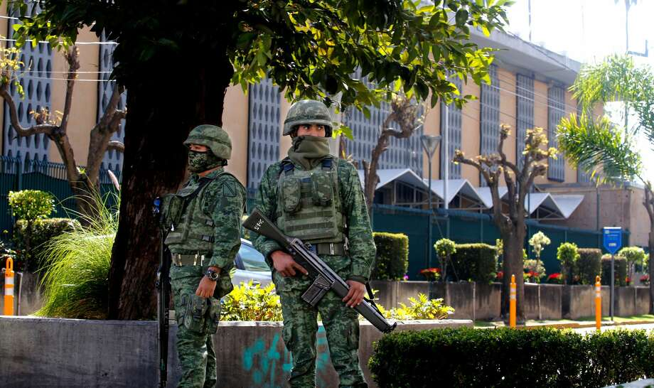 Members of the Mexican Army stand guard outside the US Consulate in Guadalajara, Mexico on December 01, 2018, after an attack with an explosive device left a wall damaged but nobody injured. (ULISES RUIZ/AFP/Getty Images) Photo: ULISES RUIZ/AFP/Getty Images