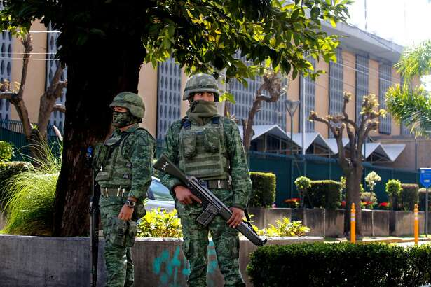 Members of the Mexican Army stand guard outside the US Consulate in Guadalajara, Mexico on December 01, 2018, after an attack with an explosive device left a wall damaged but nobody injured. (ULISES RUIZ/AFP/Getty Images)
