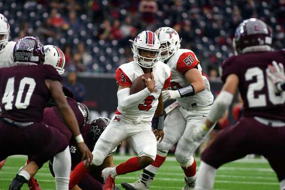 Atascocita junior quarterback Brice Matthews (3) looks for running lane between Cy-Fair defenders Tre'von Mosley (40) and Hunter Rangel (26) in the 4th quarter of their Class 6A Divison I Region III Semifinal Playoff matchup at NRG Stadium in Houston on Dec. 1, 2018.