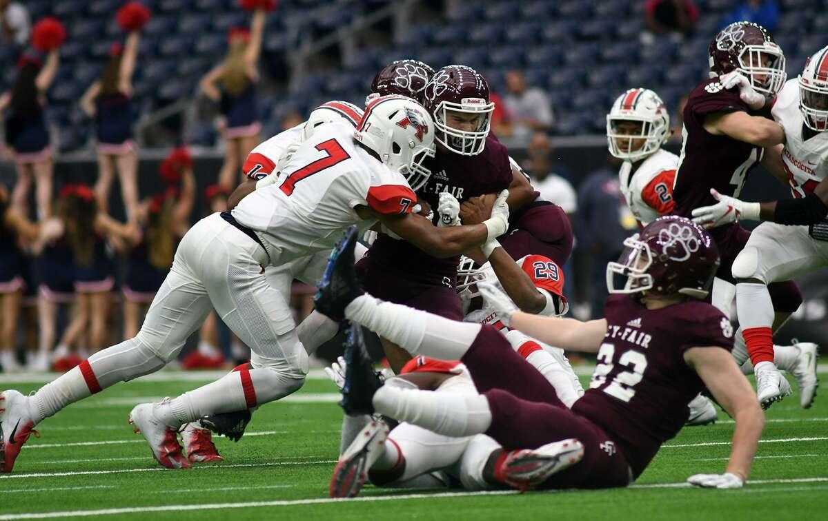 Atascocita senior linebacker Myron Morrison (7) sacks Cy-Fair senior Ryan Nelub, center, in the 2nd quarter of their Class 6A Divison I Region III Semifinal Playoff matchup at NRG Stadium in Houston on Dec. 1, 2018.