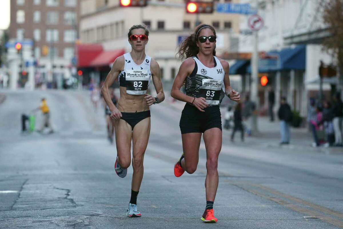 Sasha Gollish, left, and Alia Gray run in the 2018 Humana Rock 'n' Roll San Antonio Marathon and 1/2 Marathon, Sunday, Dec. 2, 2018. Gollish won first place and Gray second place in the ½ marathon.