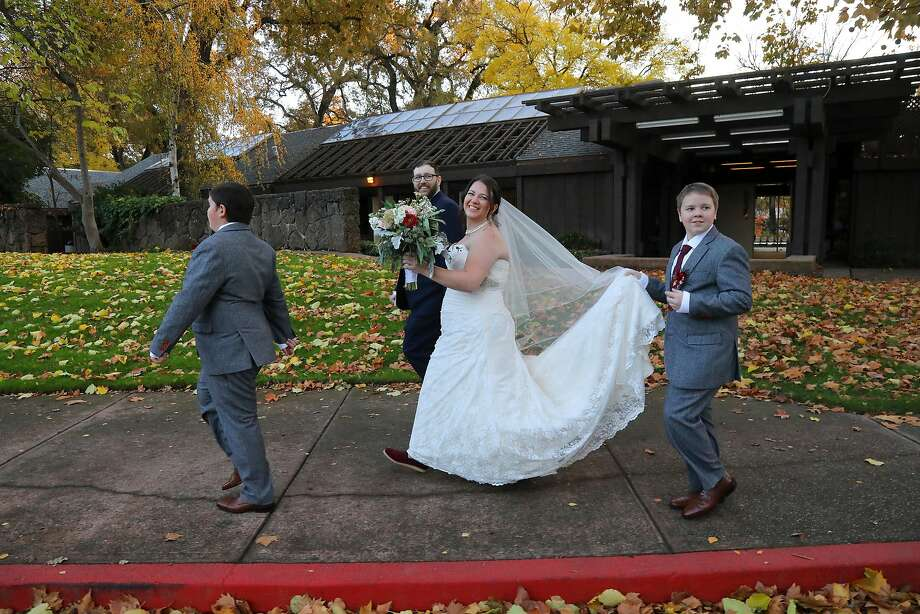Megan Janko and Joey Best celebrated their wedding with their sons at the Creekside Rose Garden in Chico, Calif., Nov. 24, 2018. About 150 guests attended the wedding, at least 50 of whom were fellow Paradise evacuees who also lost their homes. (Jim Wilson/The New York Times) Photo: JIM WILSON, NYT