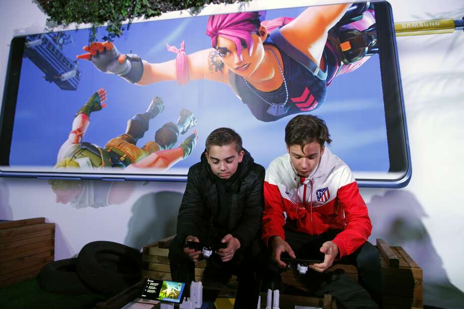 gamers play the video game fortnite battle royale developed by epic games on samsung - fortnite rehab article