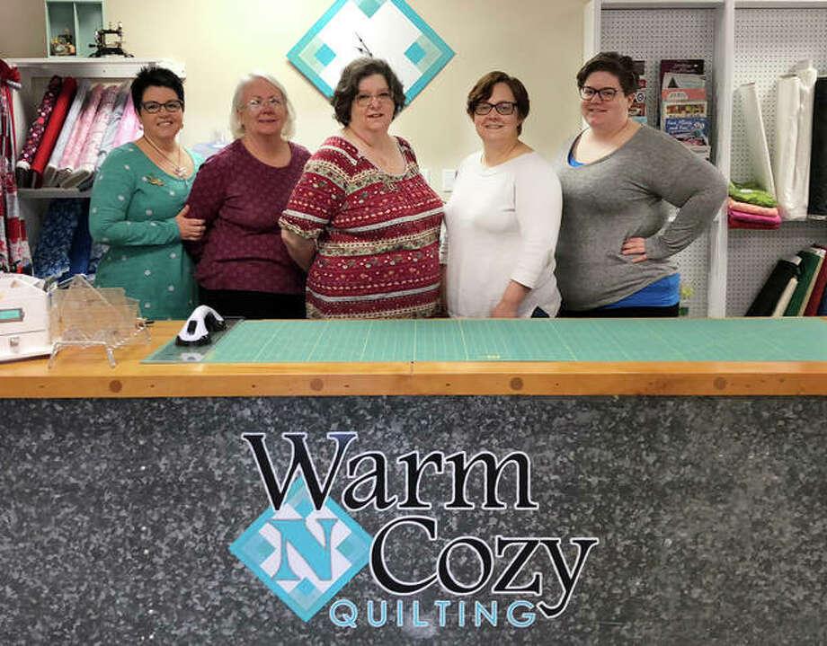(L-R): Warm N Cozy Quilting's Julie Yeager, Trish Cyvas, Debbie Chitty, Danielle Cyvas, Sarah Neuman. Photo: For The Intelligencer