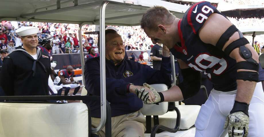 Retirement:   Houston Texans defensive end J.J. Watt shakes hands with former president George H.W. Bush before an NFL football game Cincinnati Bengals at NRG Stadium, Sunday, Nov. 23, 2014, in Houston. Photo: Karen Warren/Houston Chronicle