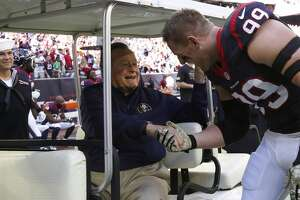 Retirement:   Houston Texans defensive end J.J. Watt shakes hands with former president George H.W. Bush before an NFL football game Cincinnati Bengals at NRG Stadium, Sunday, Nov. 23, 2014, in Houston.
