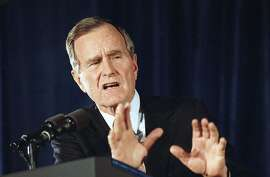 """U.S. President George H. Bush delivers remarks to the American Society of Newspaper Editors in Washington, Thursday, April 9, 1992. Bush defended his decision to end the Gulf War without the ouster of Iraqi President Saddam Hussein. Later Thursday, after hearing of the conviction of ousted Panamanian dictator Manuel Noriega, Bush commented that the conviction was """"a major victory against the drug lords."""" (AP Photo/J. Scott Applewhite)"""