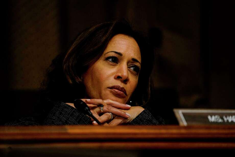 Larry Wallace, a top aide for Sen. Kamala Harris, D-Calif. (pictured), resigned over revelations he was involved in a harassment  lawsuit and settlement.  Signs Kamala Harris is running for president in 2020>>> Photo: Washington Post Photo By Melina Mara / The Washington Post