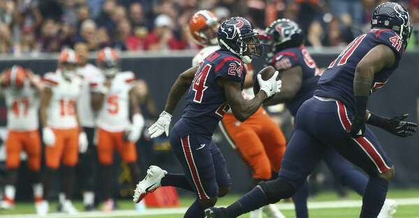 Houston Texans cornerback Johnathan Joseph (24) runs with the ball after  intercepting a pass against the Cleveland Browns during the second quarter  of an ... 116bebf8f1956