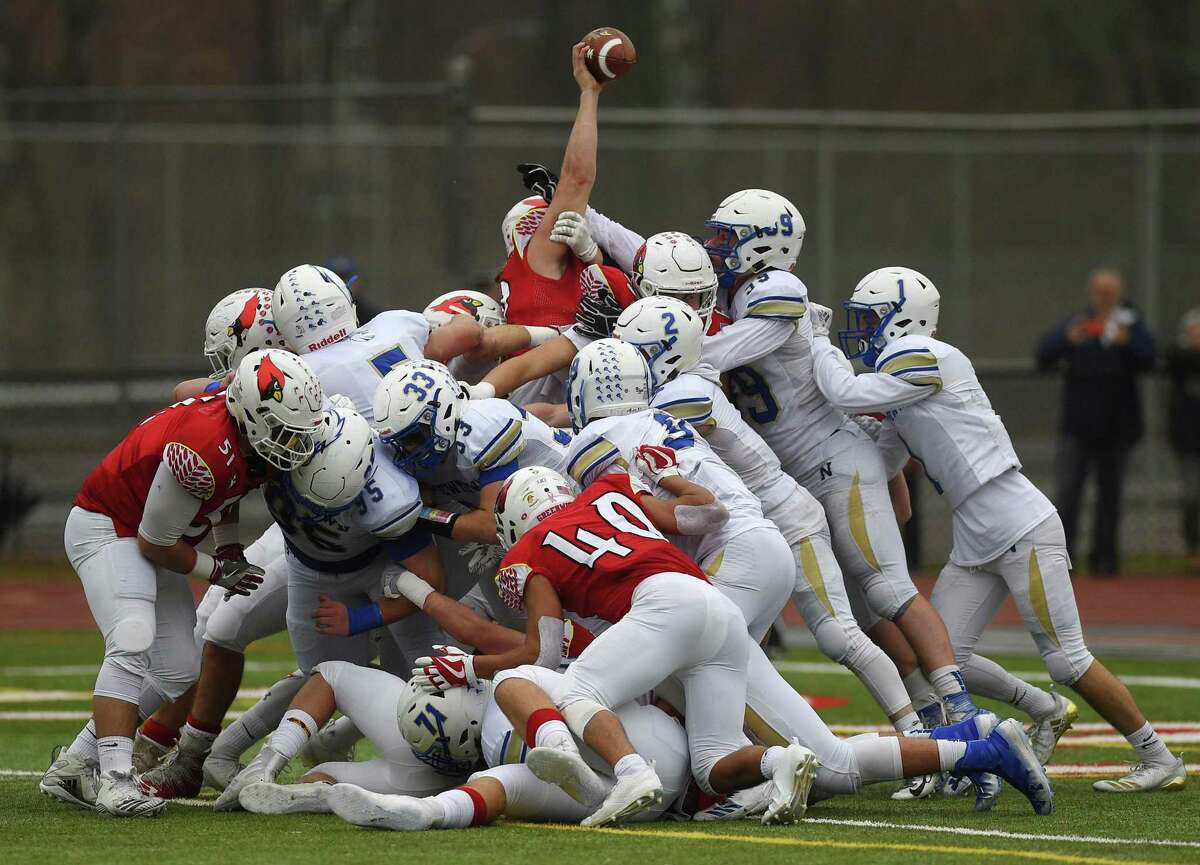 Greenwich quarterback Gavin Muir stretches the football over the goal line for a one-yard touchdown run during Sunday's Class LL semifinal game aganst Newtown on Sunday at Greenwich High School.