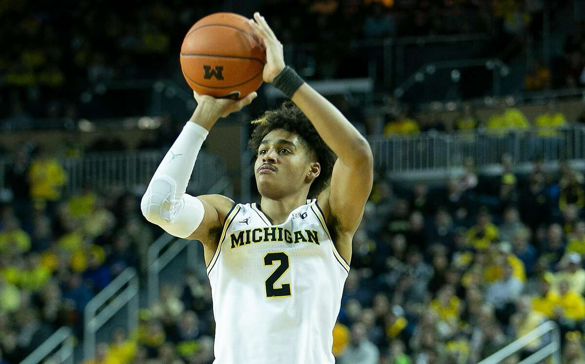 Jordan Poole #2 of the Michigan Wolverines shoots a three point shot during the second half of the game against the Purdue Boilermakers at Crisler Center on December 1, 2018 in Ann Arbor, Michigan. Michigan defeated Purdue 76-57. (Photo by Leon Halip/Getty Images)