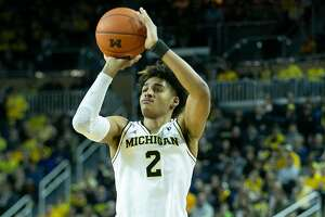 ANN ARBOR, MI - DECEMBER 1: Jordan Poole #2 of the Michigan Wolverines shoots a three point shot during the second half of the game against the Purdue Boilermakers at Crisler Center on December 1, 2018 in Ann Arbor, Michigan. Michigan defeated Purdue 76-57. (Photo by Leon Halip/Getty Images)