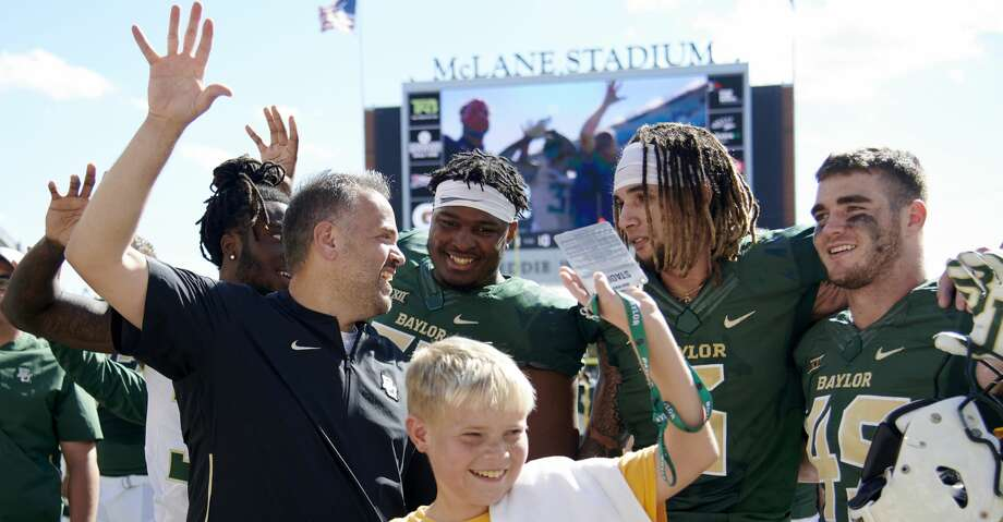 WACO, TX - NOVEMBER 3:  Baylor Bears head coach Matt Rhule celebrates with his team after defeating the Oklahoma State Cowboys 35-31 in an NCAA football game at McLane Stadium on November 3, 2018 in Waco, Texas.  (Photo by Cooper Neill/Getty Images) Photo: Cooper Neill/Getty Images