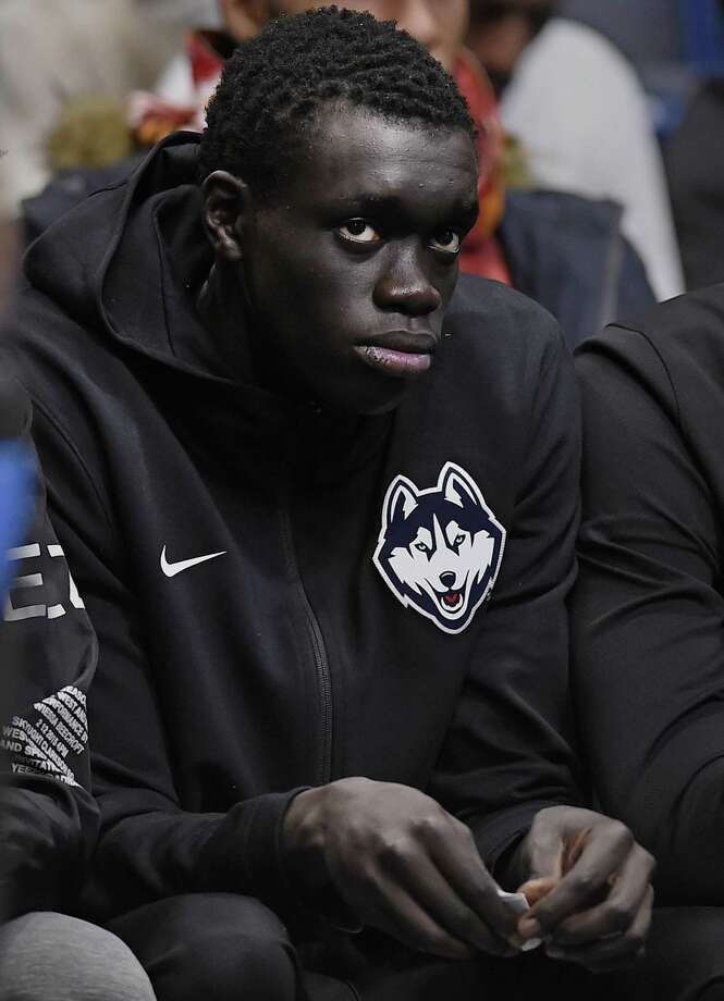 UConn commit Akok Akok watches Sunday's game between the Huskies and Arizona in Hartford. Photo: Jessica Hill / Associated Press / Copyright 2018 The Associated Press. All rights reserved